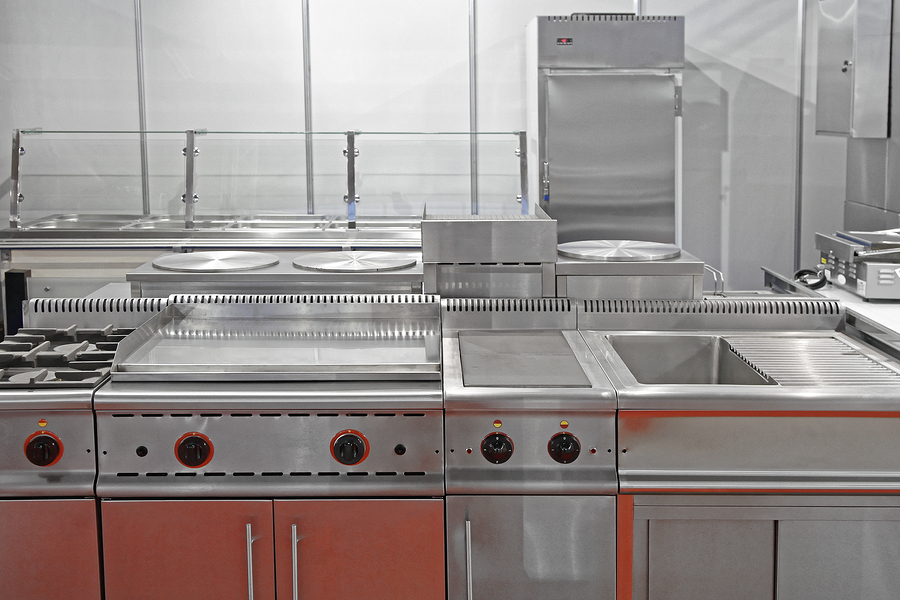 Interior of Restaurant Commercial Kitchen With Stainless Steel Equipment
